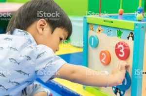 Asian Boy is playing counting educational toy